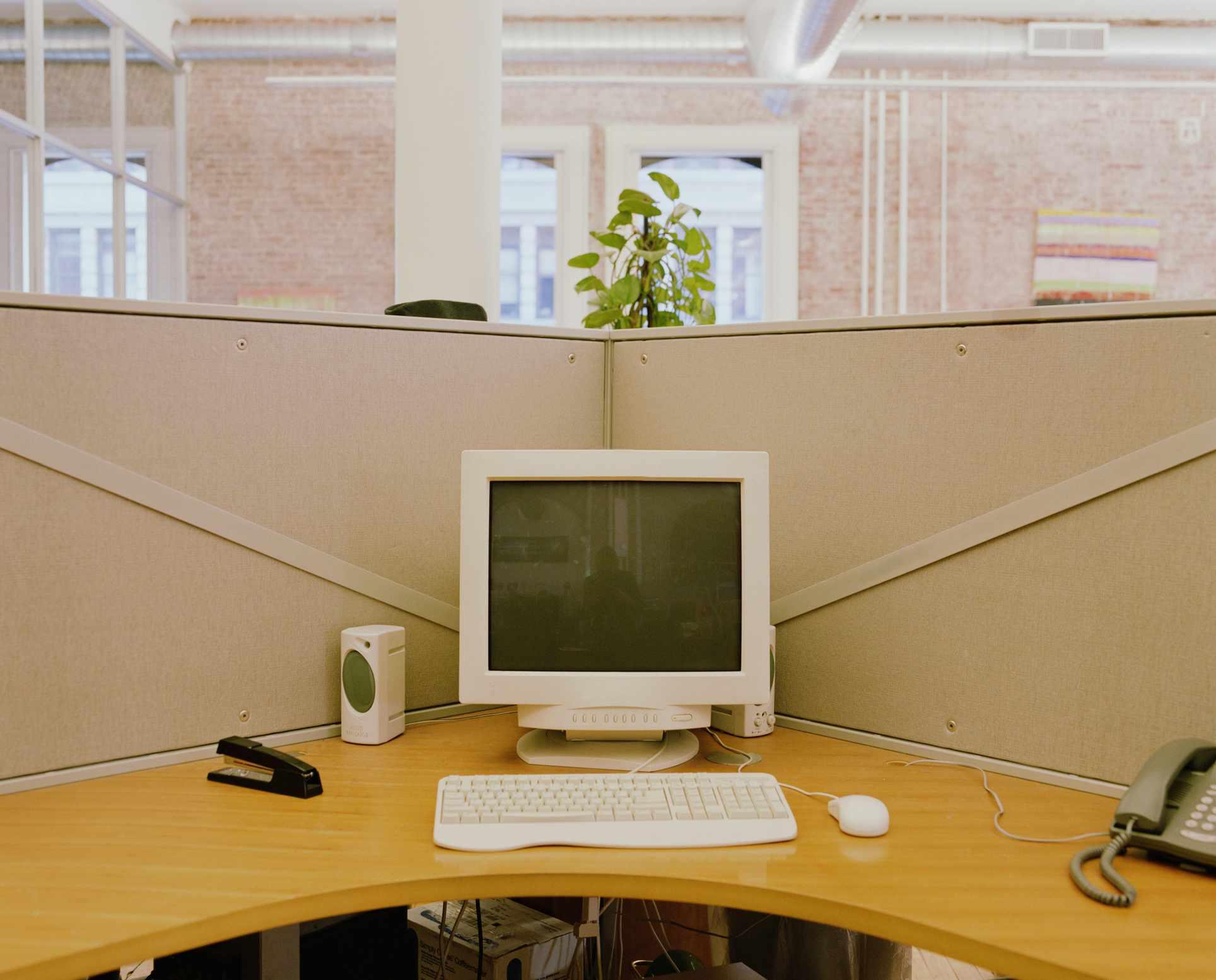 Older desktop computer at a workstation in an office