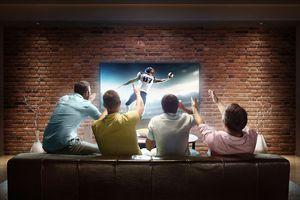 Four men watching a football game