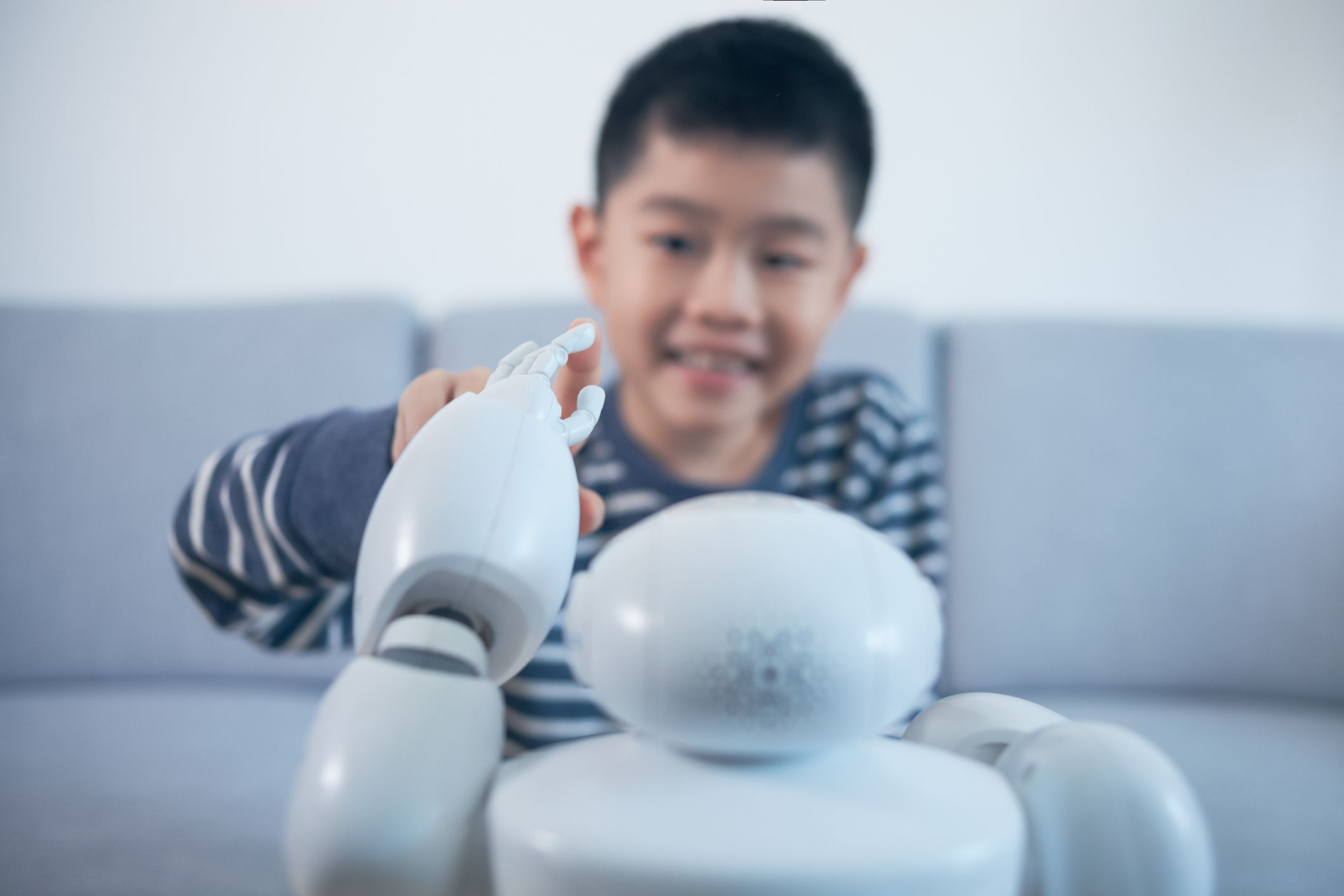 A child interacting with a robot.