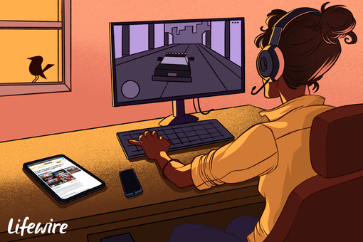 Person playing GTA Vice City on a PC, reading cheats on Lifewire via a tablet