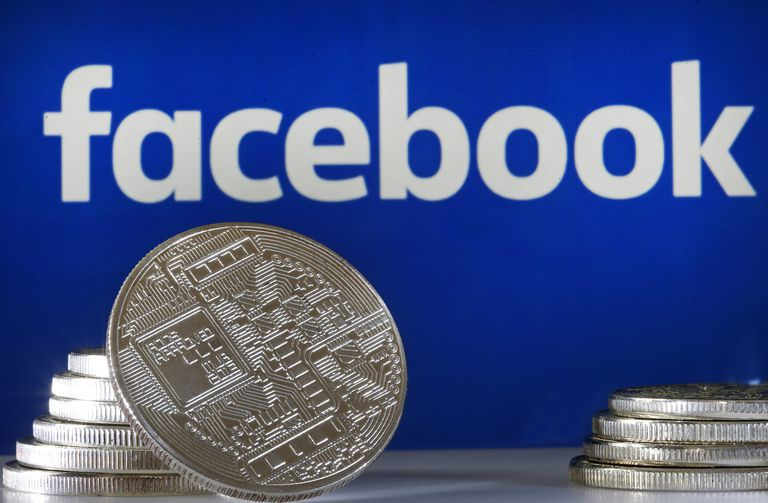 Facebook logo behind bitcoin-like coins