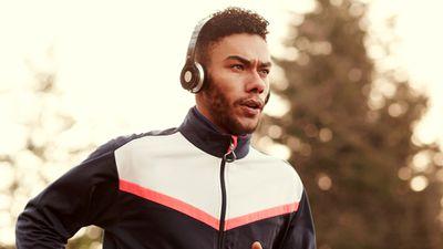 Runner with modern headphones on.