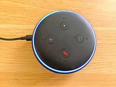 An Echo Dot with the mute button and action button pressed.