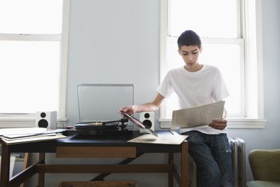 Young man listening to vinyl