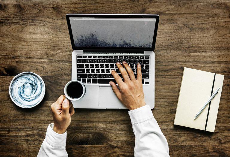 Man browsing internet on laptop