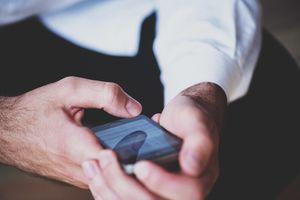 A man using social media on a smartphone.