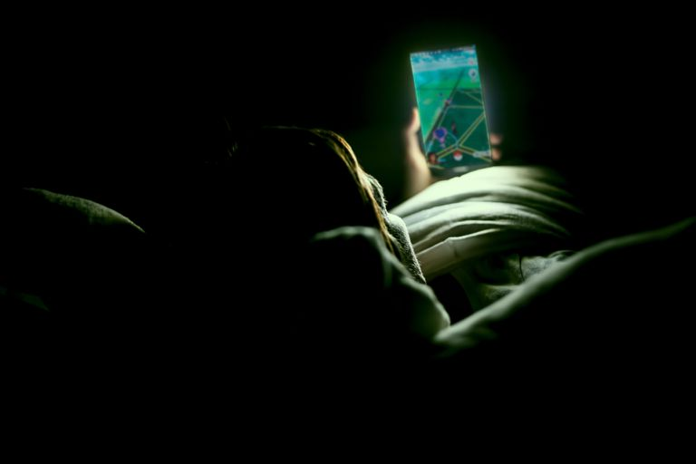 A woman uses a Pokemon Go GPS spoof to play without leaving bed.