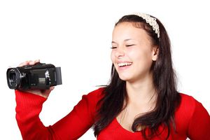 Girl holding camcorder