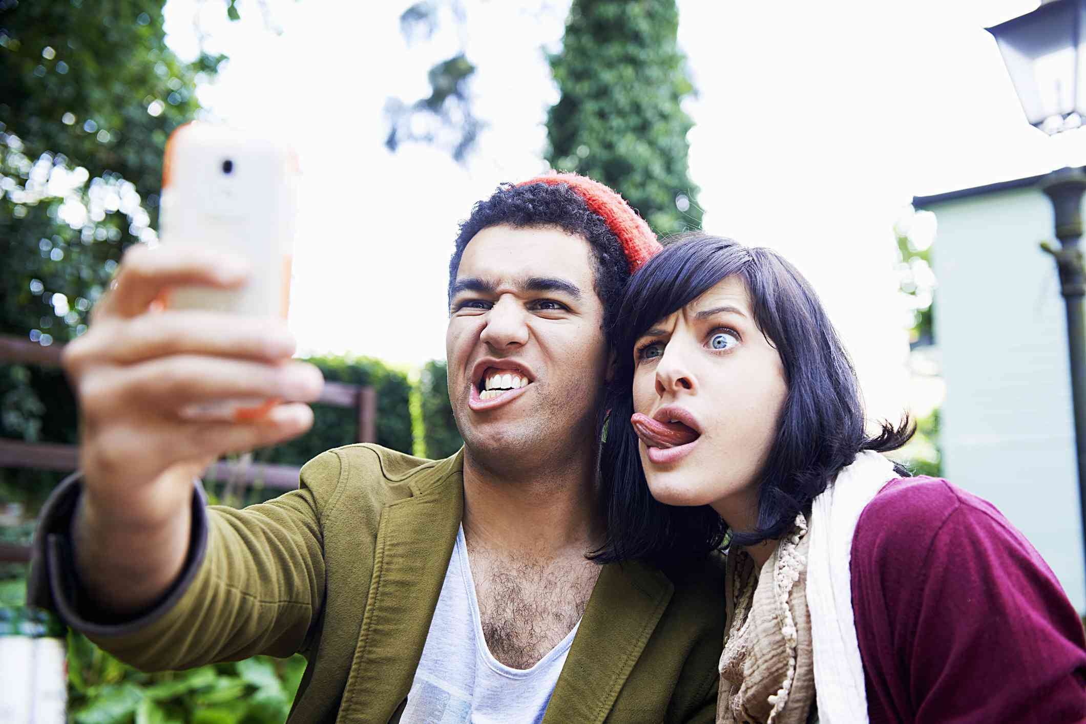 Two people taking a selfie making funny faces.