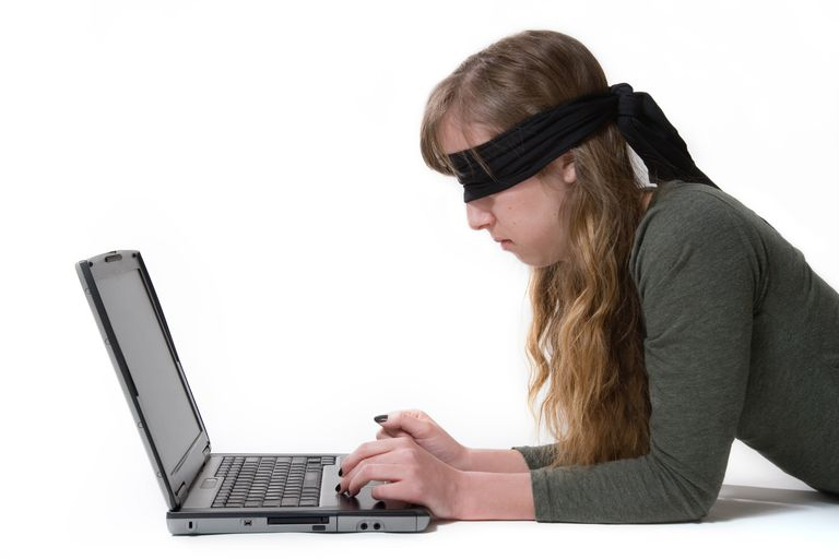 Blindfolded woman at computer