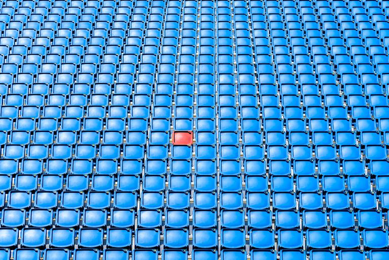Full Frame Shot Of Blue Seats surrounding one red seat in an arena