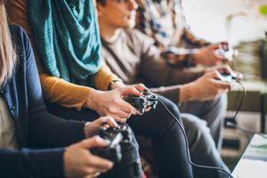 Group of friends playing digital games at home
