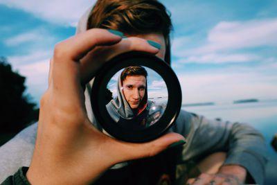 A view of a man through a fisheye lens.