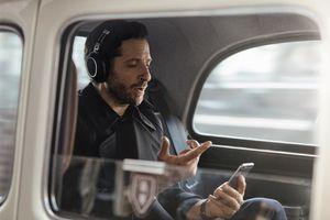 Man listening to Sennheiser headphones in a car
