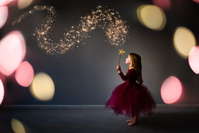 Magical composite of young girl in fairy fancy dress outfit