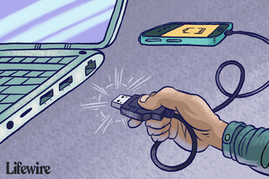 Illustration of a hand plugging a USB cord into a USB port.