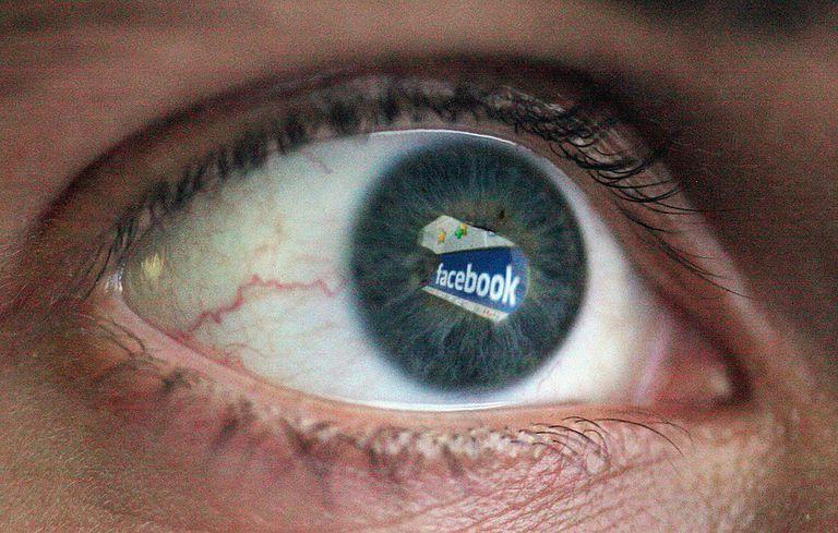 Facebook logo reflected in eye