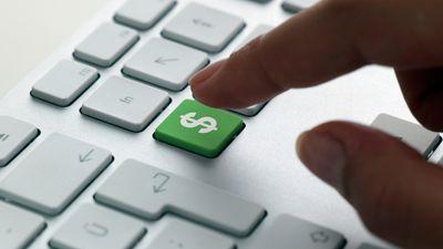 Person pressing a dollar sign key on their keyboard