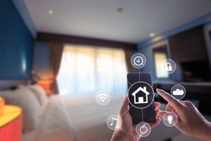 smartphone being used to wirelessly control a home