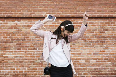 woman listening to smartphone with big headphones