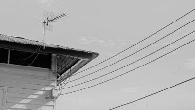 Old-fashioned antenna attached to a roof