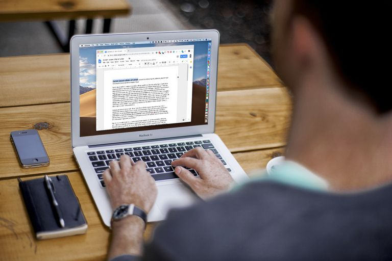 Man using Google Docs on his MacBook Air