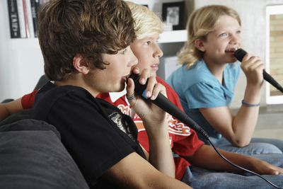 Three kids singing karaoke