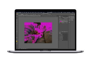 A MacBook Pro running Photoshop with a blending mode in place