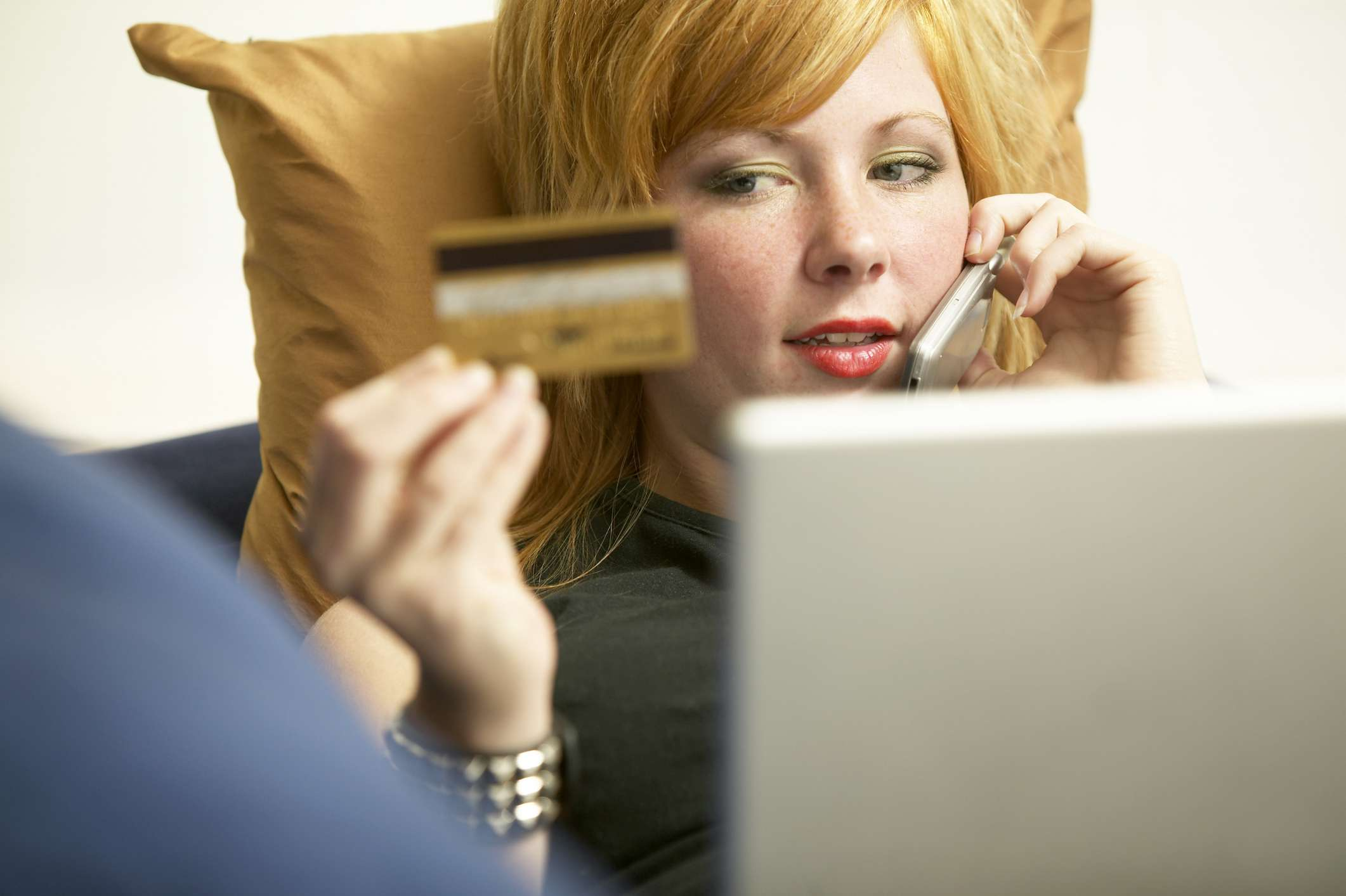 Woman Paying over the Phone with Credit Card