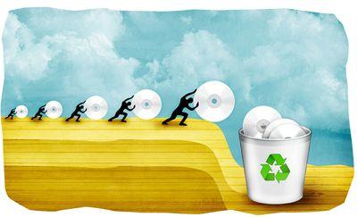 Human figures rolling cds into a recycling bin