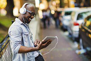 Man listening to music on iPad