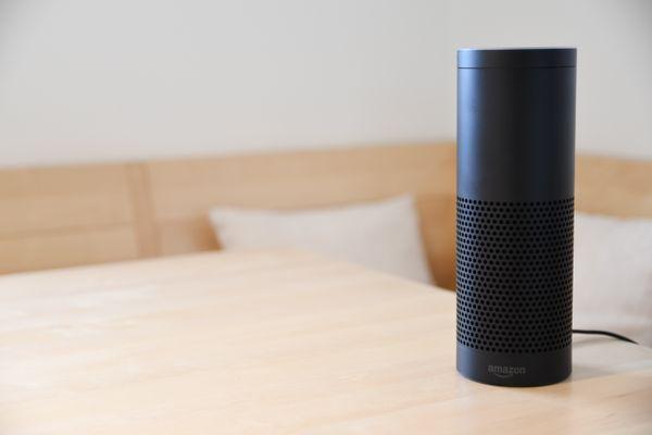 Amazon Echo atop a table.