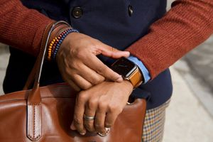 A person checking their Apple Watch