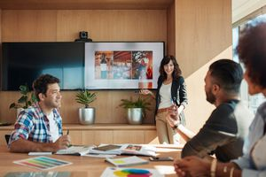 Group of creative designers in board room