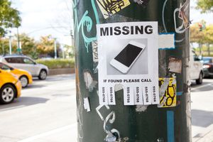 Flier for a missing iPhone tacked to a light pole in the city.
