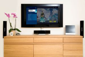 A player adds a friend on Fortnite on their flatscreen television.