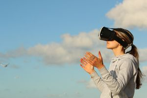 Someone using a virtual reality headset outside.