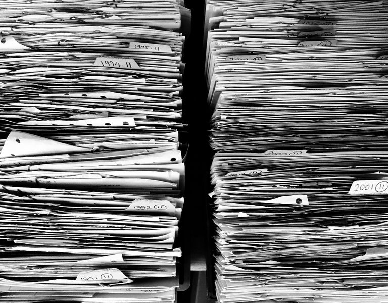 Two stacks of unsorted papers