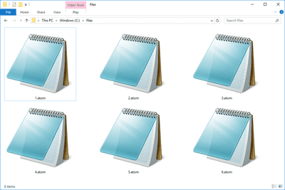 Screenshot of several ATOM files in Windows 10 that open with Notepad