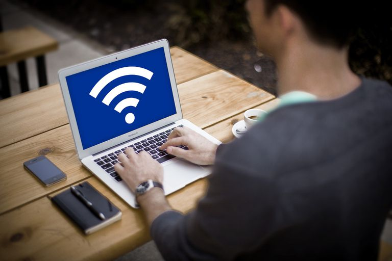 Wi-Fi logo on laptop on outside table