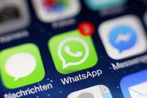 The WhatsApp app logo on an iPhone screen.