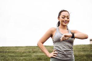 Woman wearing fitness tracker outdoors