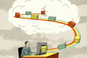 Businessman cloud computing sending storage boxes on conveyor belt from desktop computer to cloud