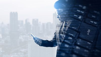 The double exposure image of the businessman using a smartphone overlay with source code and keyboard image and copy space. The concept of programming, cyber security, business and internet of things.