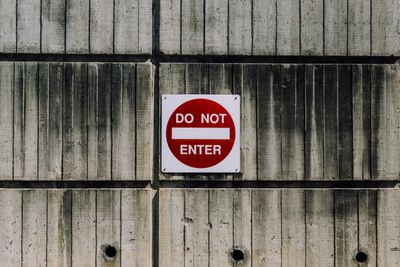 DO NOT ENTER sign on a wooden wall