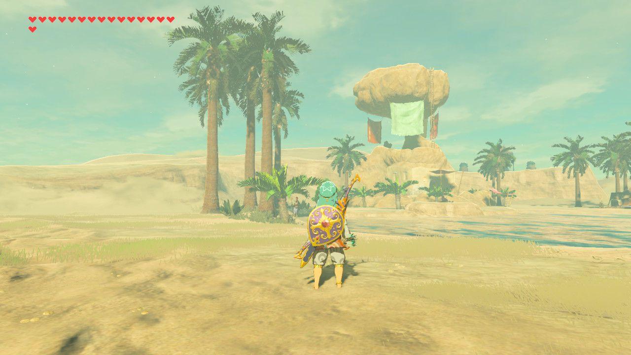 Standing at Kara Kara Bazaar oasis in The Legend of Zelda: Breath of the Wild.