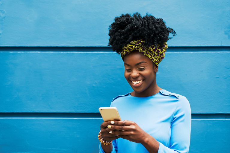 Young woman looking at iPhone
