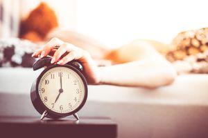 woman shutting off alarm