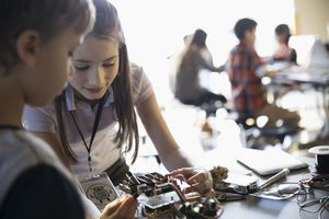 Boy and girl learning robotics in classroom