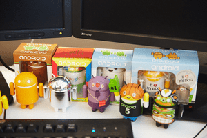 Picture of an assortment of Android figurines wearing costumes